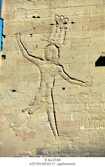 HORUS CARVING ON PYLON OF THE TEMPLE OF ISIS; PHILAE, AGILKIA ISLAND, ASWAN, EGYPT; 10/01/2013