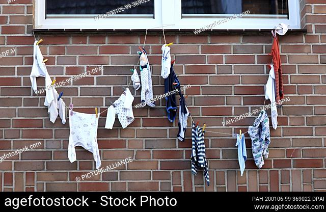 20 December 2019, Mecklenburg-Western Pomerania, Crivitz: In front of the MediClin hospital at Crivitzer See, children's and baby's things hang under a sign...