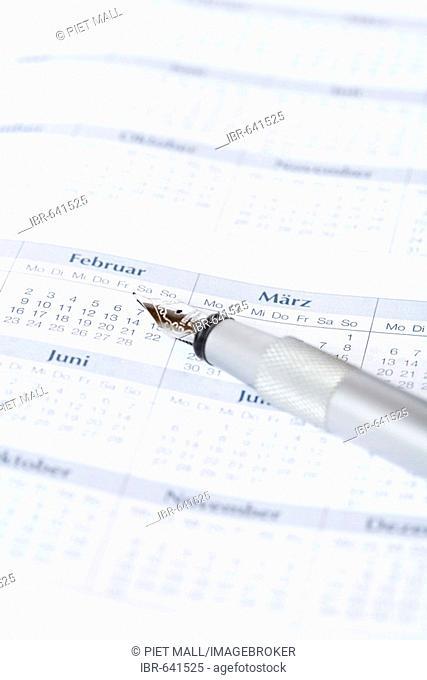 Pen laying on a calendar