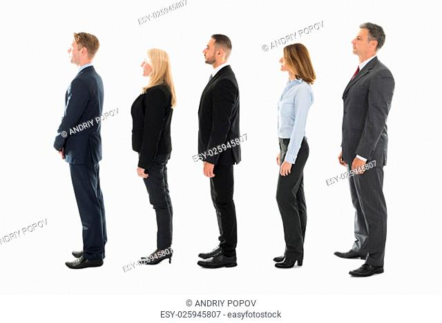 Full length side view of business people standing in row over white background