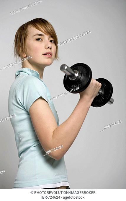 Young woman exercising with a dumbbell