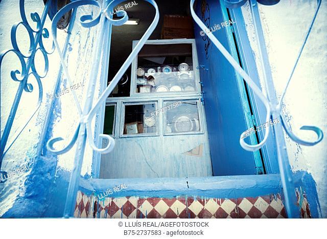 Watchmaker's blue door. Chauen, Morocco