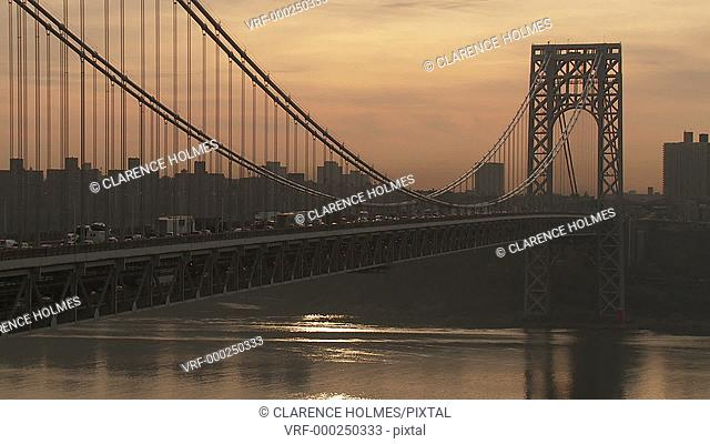 Morning rush hour traffic on the George Washington Bridge crosses the Hudson River between New Jersey and New York