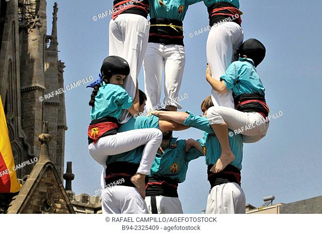 Castellers, human traditional tower next to the Sagrada Familia temple, Barcelona, Catalonia, Spain