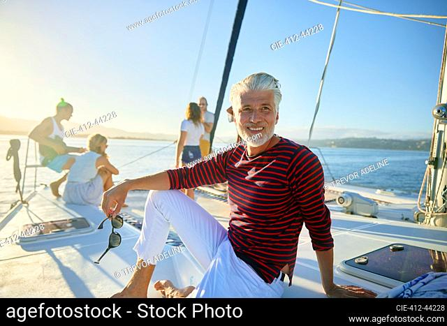 Portrait smiling man relaxing on sunny boat