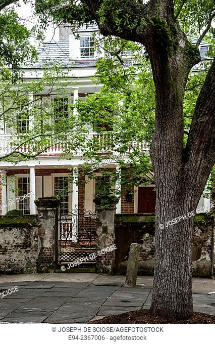 Historic home in Charleston South Carolina showing an iron gate in front