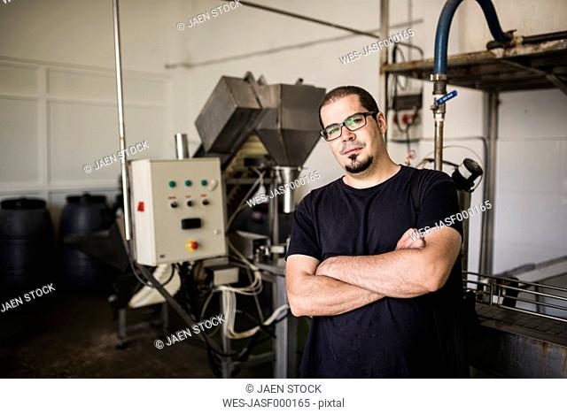 Portrait of worker in food processing plant