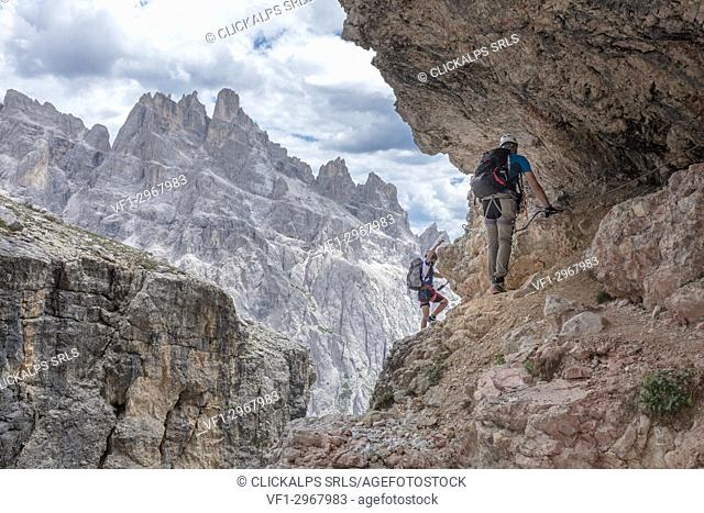 Climbers on the via ferrata Cengia Gabriella, Popera group, Giralba, Sexten Dolomites, Belluno, Veneto, Italy