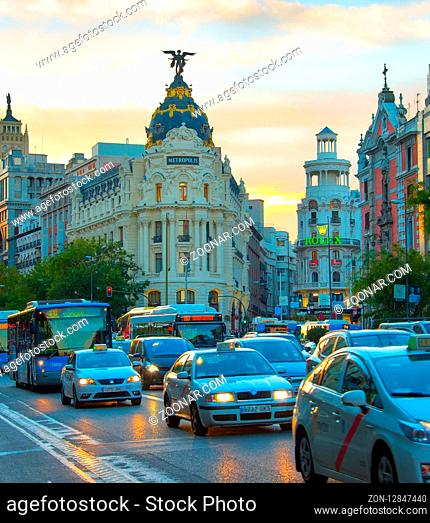 MADRID, SPAIN - NOVEMBER 07, 2016: Traffic on Madrid city center road at sunset. Madrid is the capital of Spain