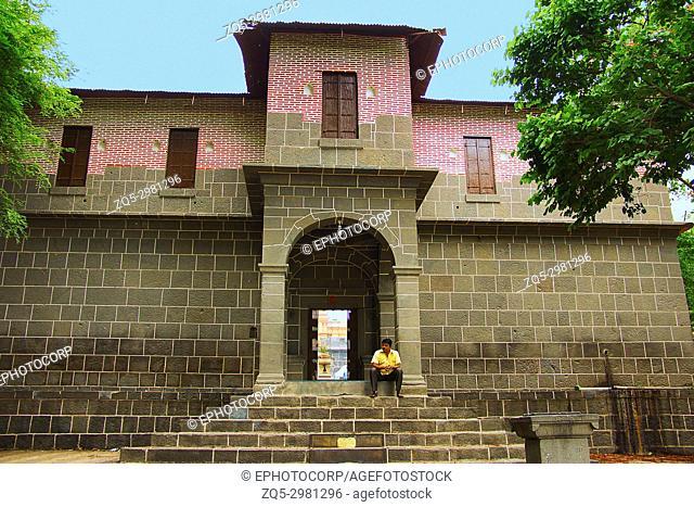 Man sitting on steps, exterior of Vitthal Mandir, Vithalwadi wadi, Prati Pandharpur, Pune