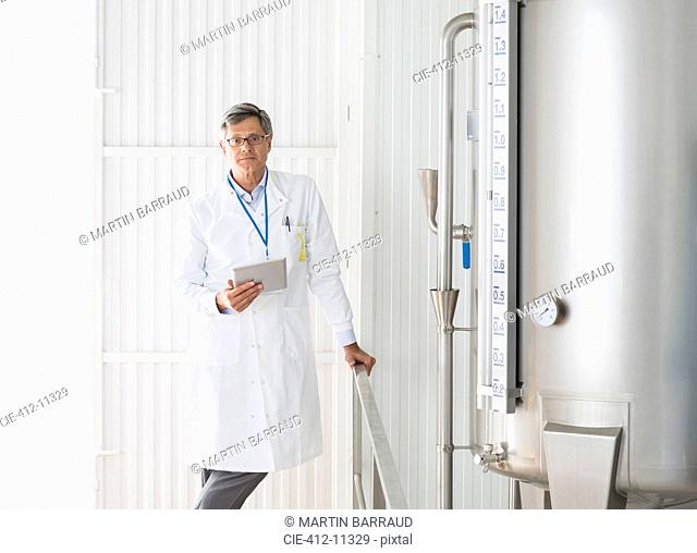 Scientist smiling in food processing plant