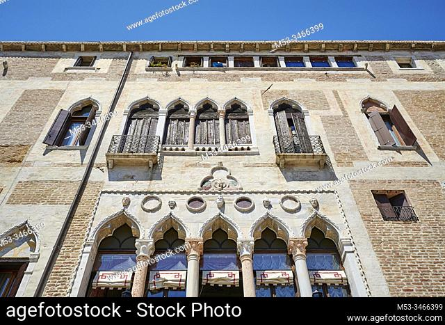 The facade of Badoari Palace, a gothic style building currently used as luxury hotel. Sestiere Castello. Venice. Veneto. Italy