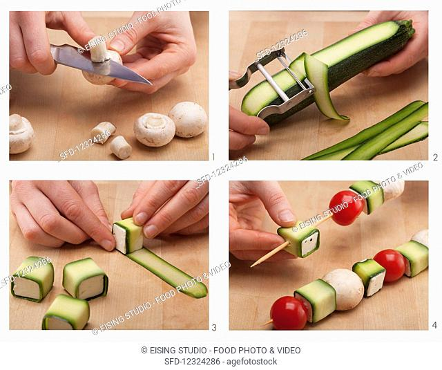 Feta and vegetable skewers being made