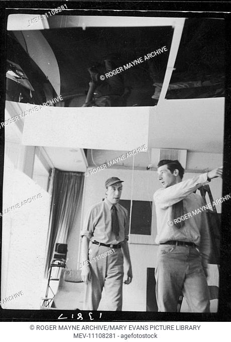 Richard Hamilton (left, 1922-2011), English pop artist, setting up an exhibition at the ICA (Institute of Contemporary Arts), Dover Street, London