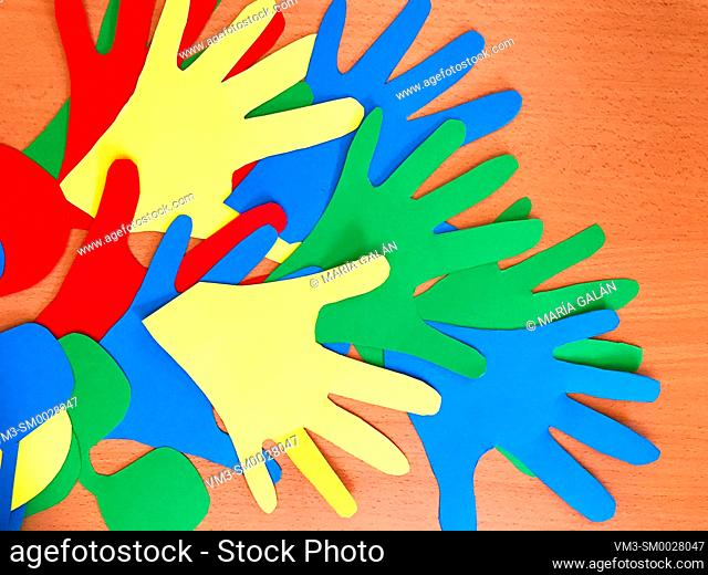 Hands made with color cardboards