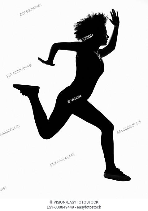 beautiful funny young afro american woman runnner running in silhouette shadow on studio isolated white backgroung