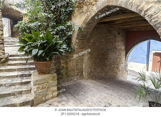 Ancient street view, carrer avall, of medieval village of Angles, province Girona, Catalonia