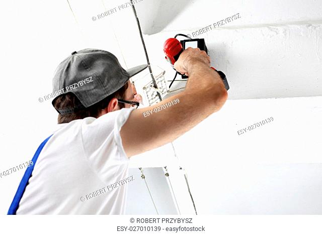 installation of ceiling. electrician repairs installations