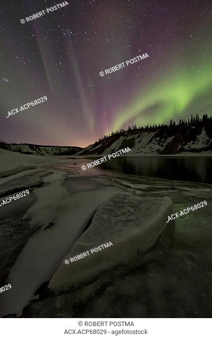 Aurora borealis or northern lights over the Yukon River, Yukon