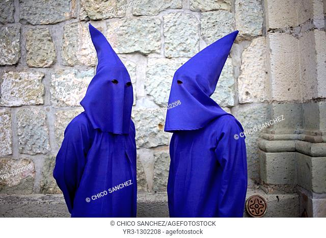 Penitents speak before a holy week procession in Oaxaca, Mexico, April 10, 2009