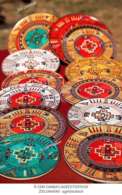 Close-up shot of wooden bowls and plates at the open-air market in Pisaq, Sacred Valley, Cuzco Region, Peru, South America