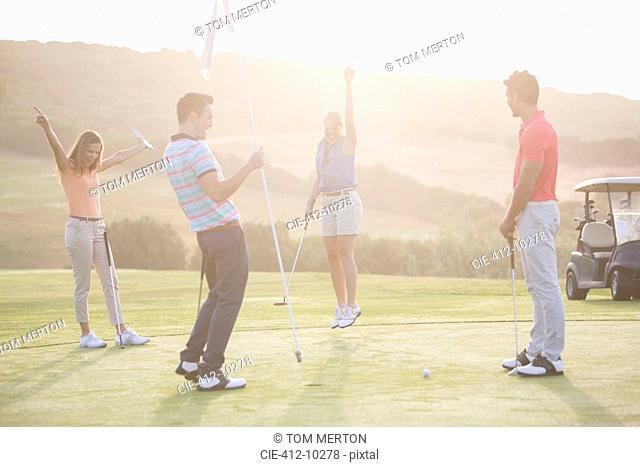 Enthusiastic friends on golf course