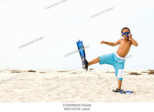 Boy wearing snorkel and flippers