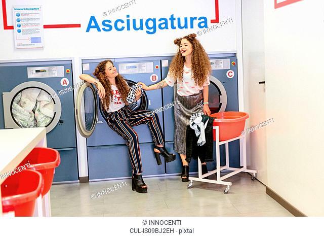 Fashion blogger twins at laundrette