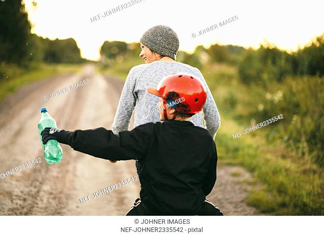 Mother with daughter cycling