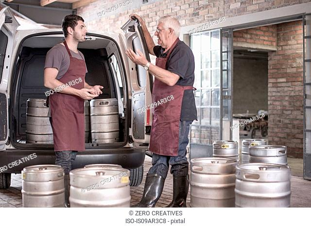 Brewers loading kegs into back of van