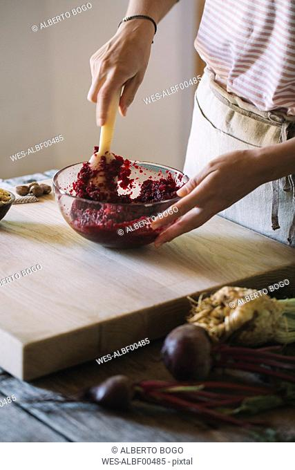 Preparation of beetroot ravioli with sage and butter, pounding the filling