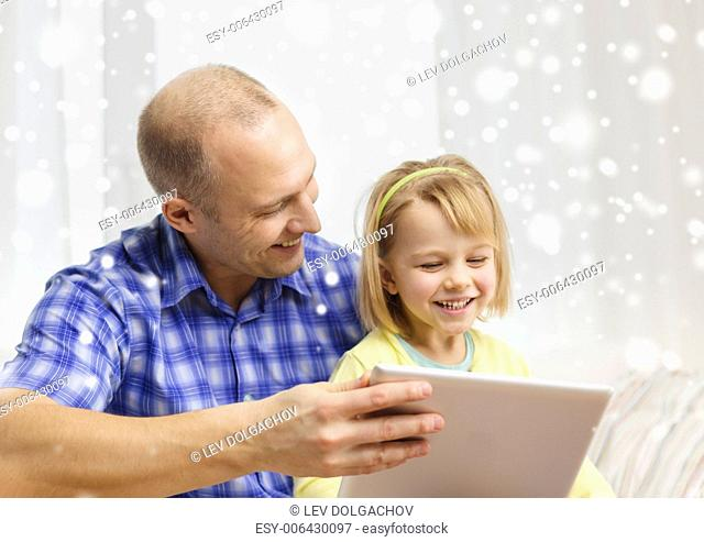 family, children, technology and people concept - happy father and daughter with tablet pc computer at home