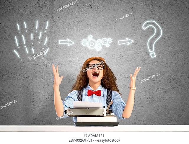 Young emotional girl writer using typing machine