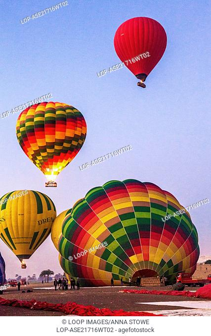 Hot air balloons preparing for flight on the West Bank of the Nile in Egypt