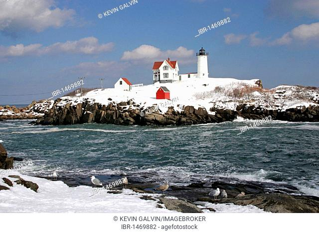 Nubble Light lighthouse, winter, snow, York, Maine, New England, USA