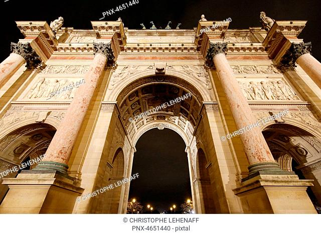 Paris. 1st district. Louvre Museum by night. The triumphal arch of the Louvre carousel