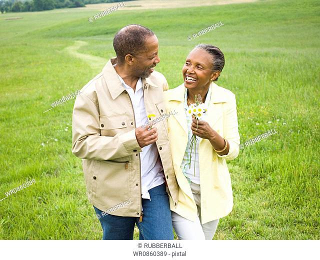Close-up of a senior man and a senior woman smiling