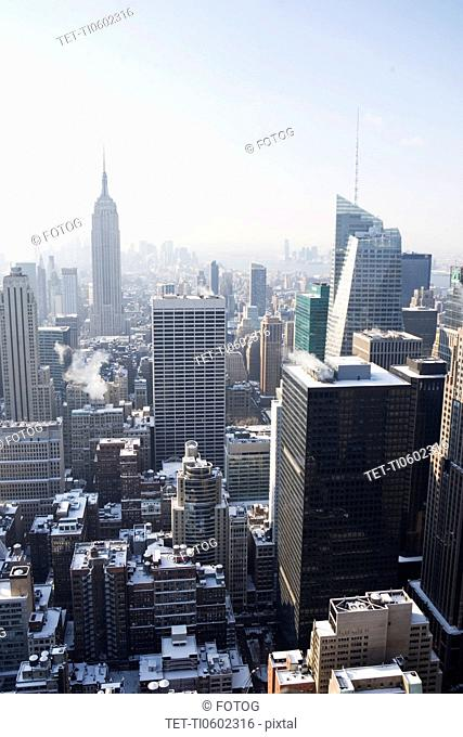 USA, New York City, View of Manhattan covered with snow, with Empire State Building in background