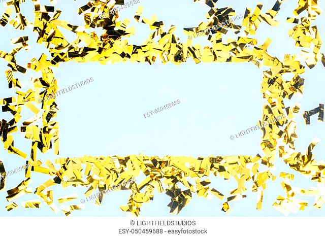 top view of beautiful frame made of golden confetti isolated on white