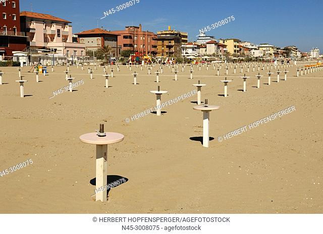 A row of small Poles at Sandy Beach, scenic View at the Beach, Viserbella Beach, Buildings, Hotels of Viserbella, Emilia Romagna, Provence of Rimini