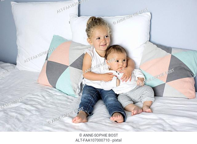 Little girl with baby brother, portrait
