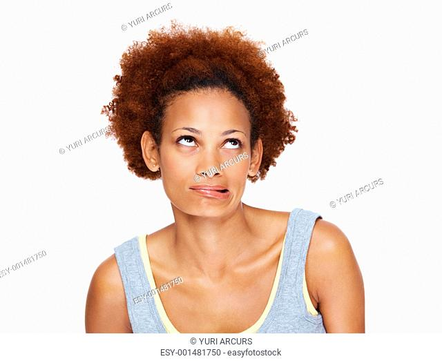 Portrait of a naughty young woman making a silly face against white background