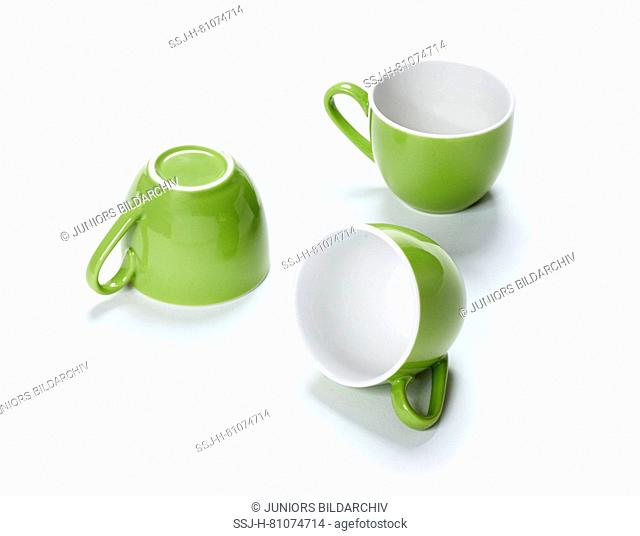Three green espresso cups. Studio picture against a white background