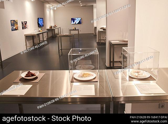 11 June 2021, Berlin: Tripe (l-r) , bull's testicles and bull's penis lie side by side in display cases in the Disgusting Food Museum Berlin
