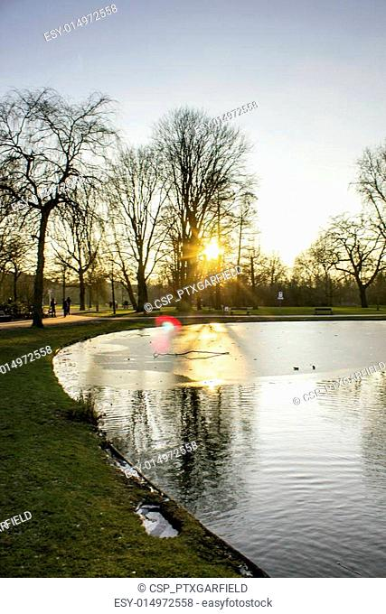 Sunset in Vondelpark, Amsterdam. Is a public urban park of 47 he