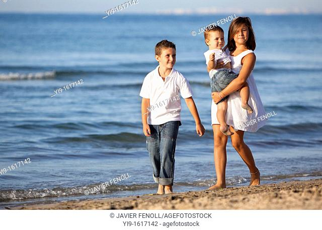 children walking on the beach