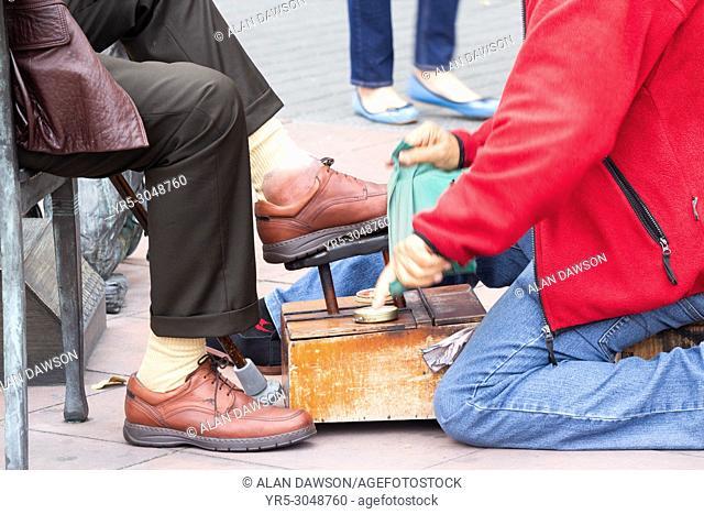 Shoe shiner in Parque Santa Catalina in Las Palmas, Gran Canaria, Canary Islands, Spain