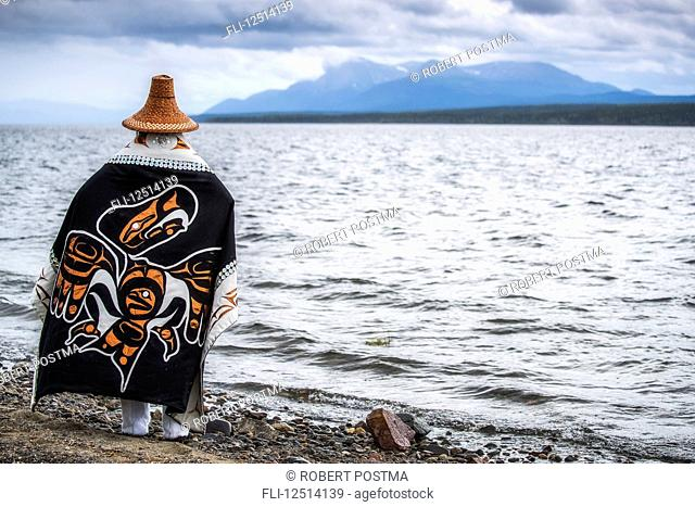Tlingit first nation woman in traditional wardrobe on the shores of Teslin Lake; Teslin, Yukon, Canada