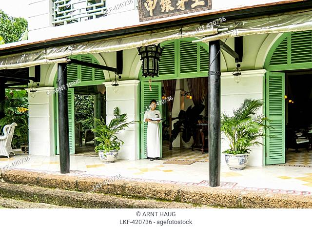 Young women at the entree of the restaurant Le Longanier in Cai Be, Mekong Delta, south Vietnam, Vietnam, Asia