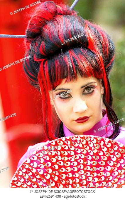 20 year old woman in Asian themed hair and make up, outdoors looking at the camera. Birmingham, Alabama, USA